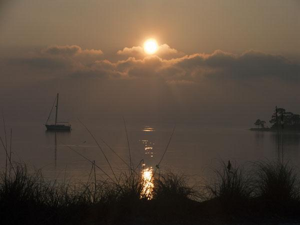 Sunrise at St. Josephs State Park in Florida with a Lone Sailboat