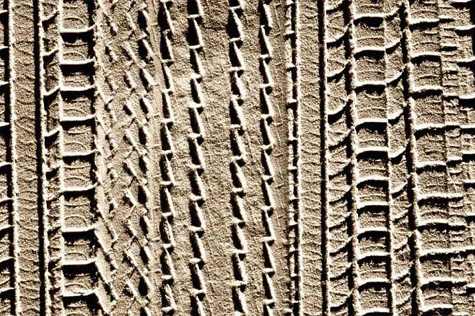 Tire Tracks in the Sand A Sepia Toned Abstract