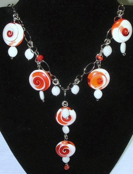 SOLD Beaded Necklace featuring round Operculum Shell Charms made of orange