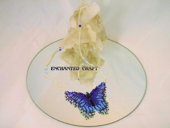 Blue beaded butterfly necklace with crystal accents