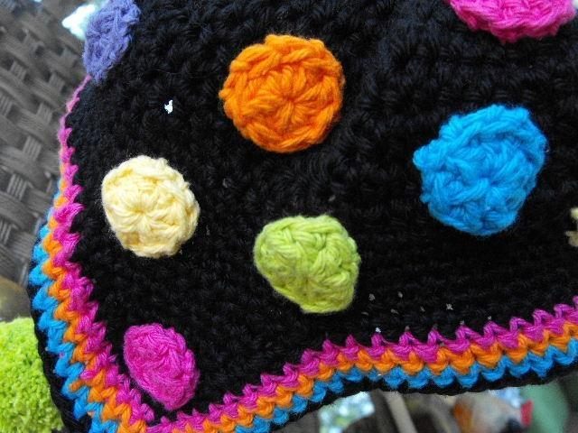 HOT DOTS EARFLAP HAT BLACK BASE WITH NEON POMS AND