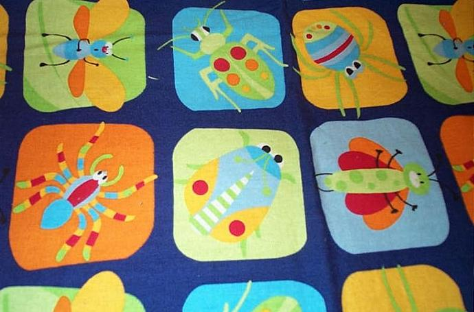 "100% cotton BUG patch blanket, 34"" x 41""."