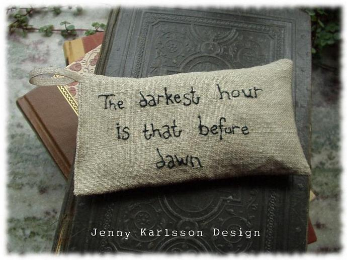 Lavender sachet in linen with embroidered text The darkest hour is that before