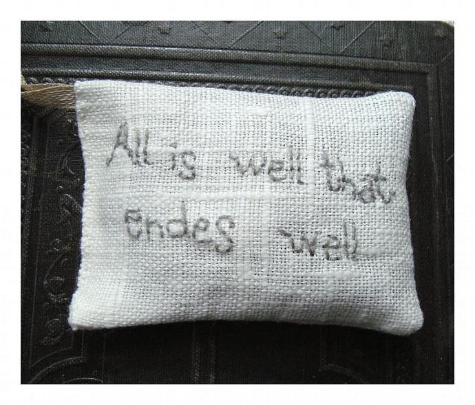Lavender sachet in white linen with embroidered text 'All is well that endes