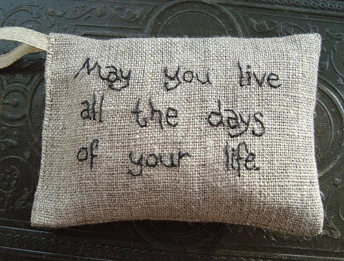 Lavender sachet in natural linen with embroidered text 'May you live all the