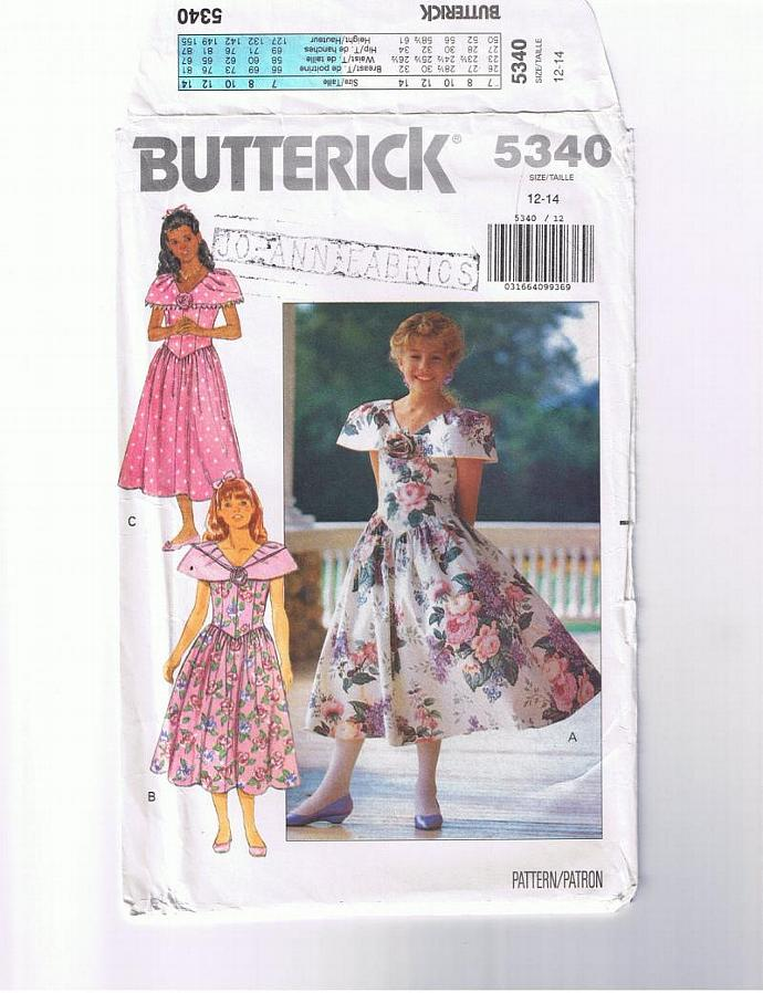 Sleeveless dress with shawl-type collar.  Flower girl dress.  Butterick pattern