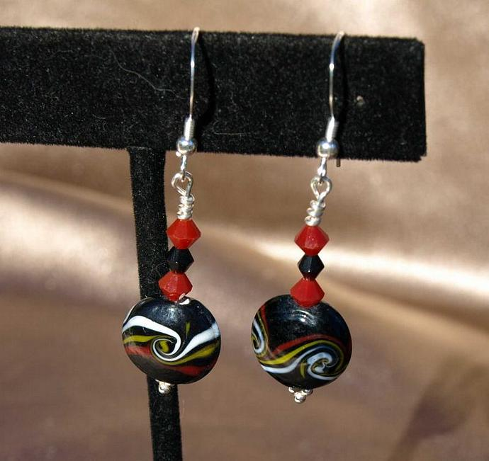 Black Disks with Swirls of Red, Yellow and White Earrings 9020
