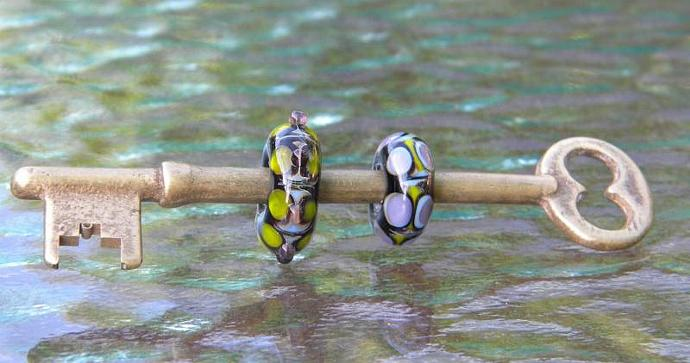 Brass skeleton key with 2 lampwork beads