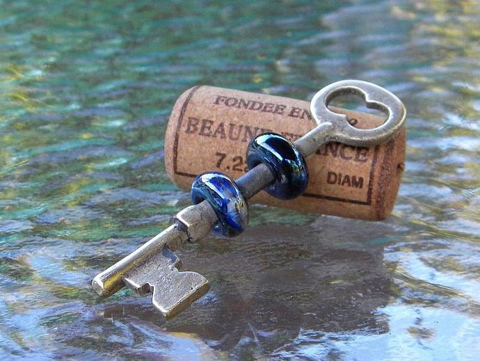 Brass vintage skeleton key with 2 beads
