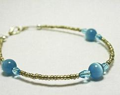9c24ce81a3 CLEARANCE Silver and Blue Cats Eye Glass Bracelet