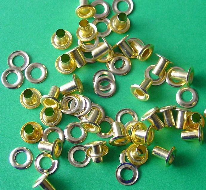 brass eyelets and washer sets in clear storage boxes