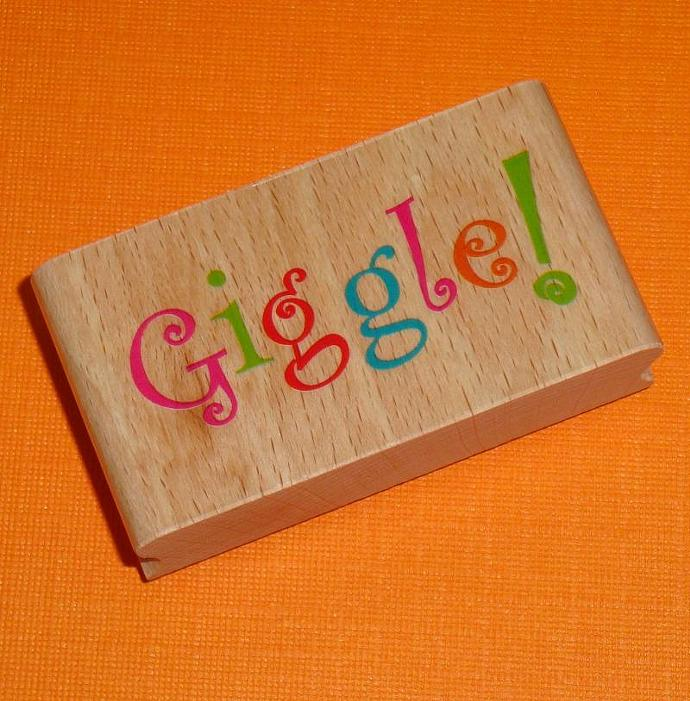 rubber stamp  / GIGGLE . wood mounted