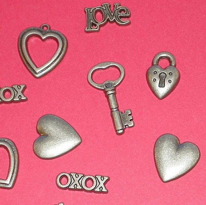 love and hearts . metal embellishments . 6 styles / 12 pieces