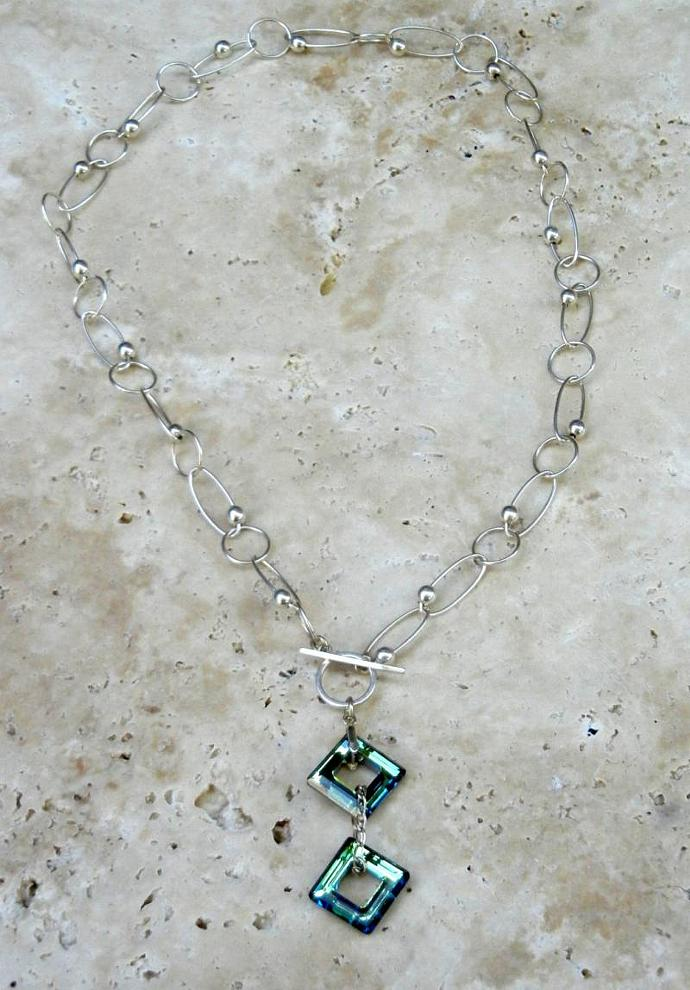 Sterling Silver Swarovski Crystal Necklace w/ Bermuda Blue Square Rings.  By
