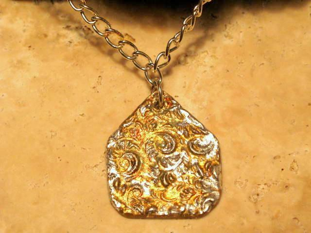 Ceramic Mottled Gold Silver Aged Pendant.