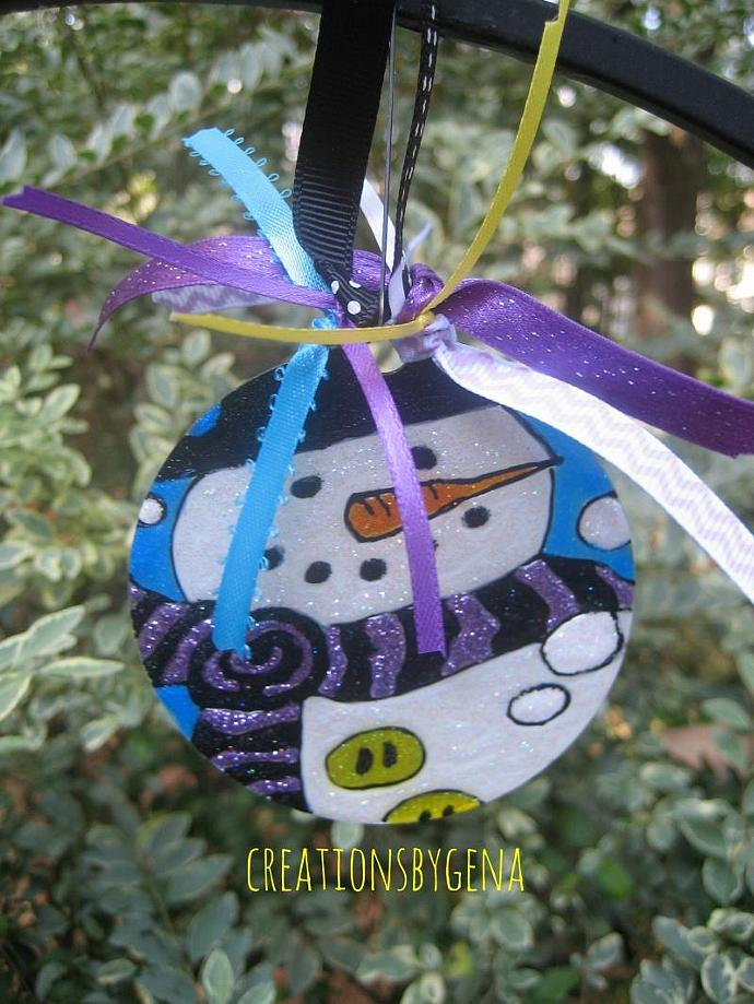 hand painted snowman ornament on acrylic round