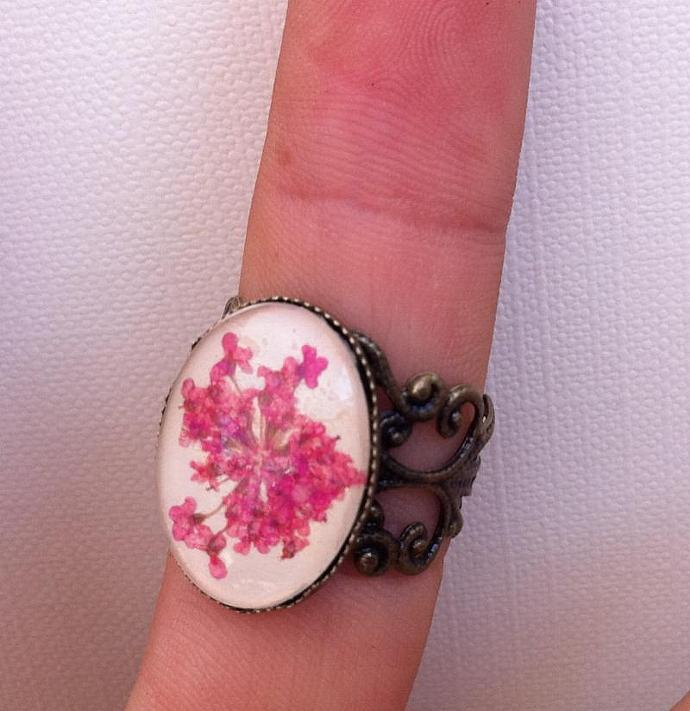 filigree ring with leather, real pressed pink flowers and glass cabochon