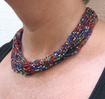 Beaded necklace multi-strand red blue green