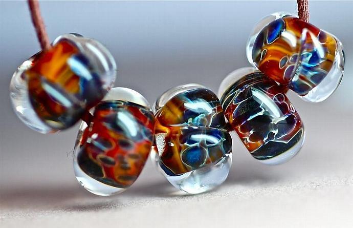 Handmade Boro Lampwork Beads in sunset yellow and reds with navy blues Majolica
