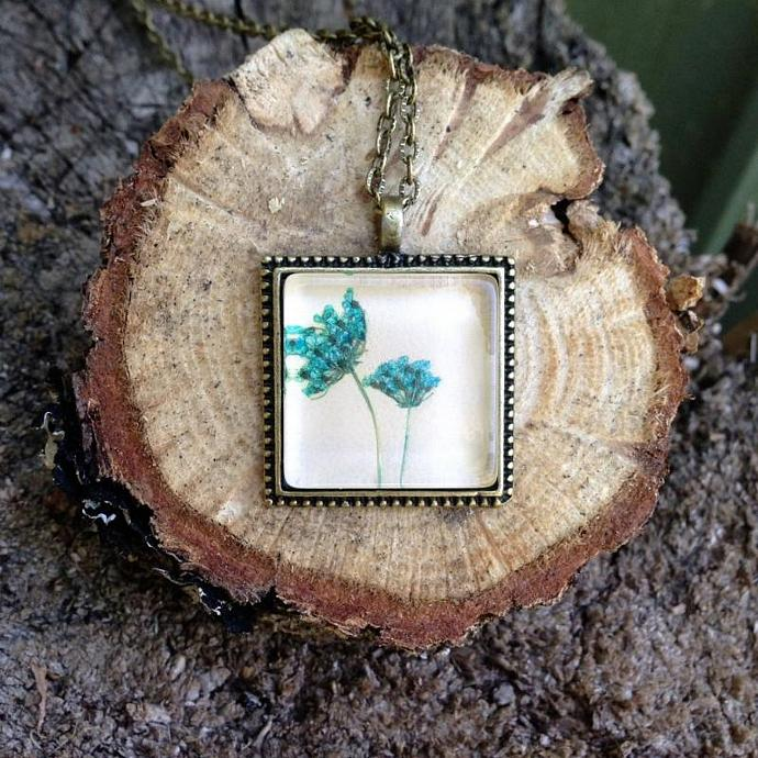 Beautiful bronzed turquoise blue  flower necklace with real light blue died