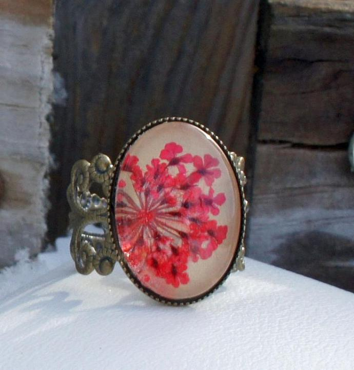 real flower ring with beige leather, real pressed red little flowers and glass