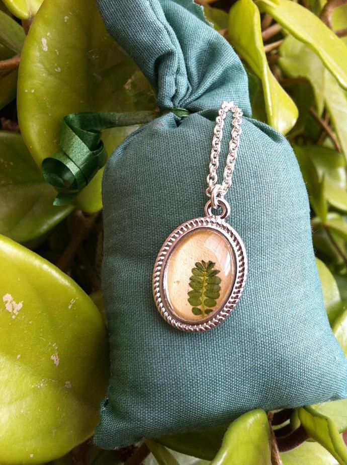 pretty botanical necklace with a real pressed handpicked leaf and a glass