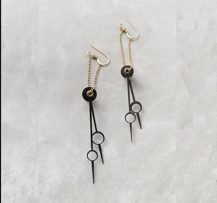 Earrings made of antique clock hands hanging on gf chain..