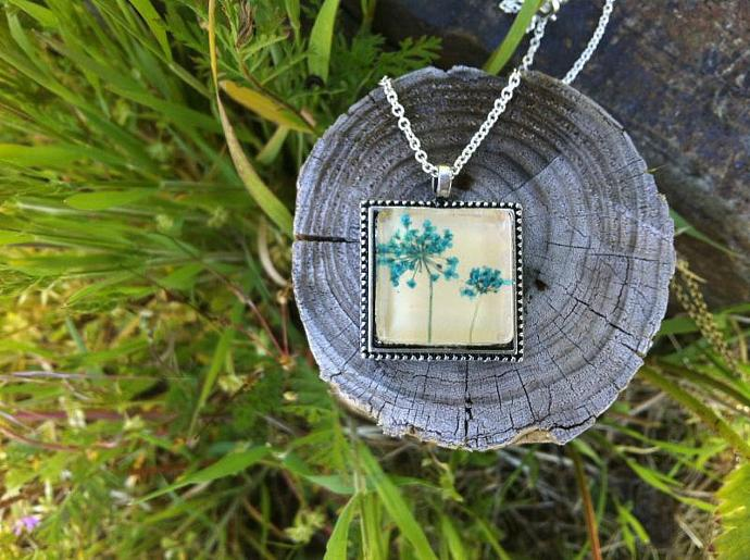 cute blue necklace with real light blue dyed pressed flowers and glass cabochon