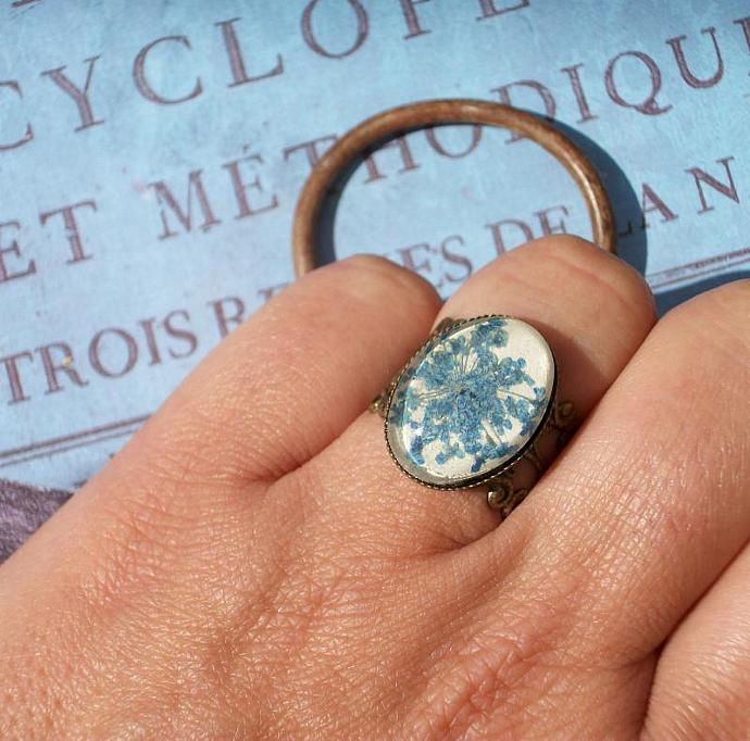 cute blue ring with beige leather, real pressed blue little flowers and glass