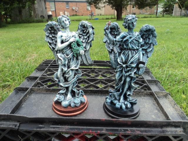 A set male angels hand painted ceramics