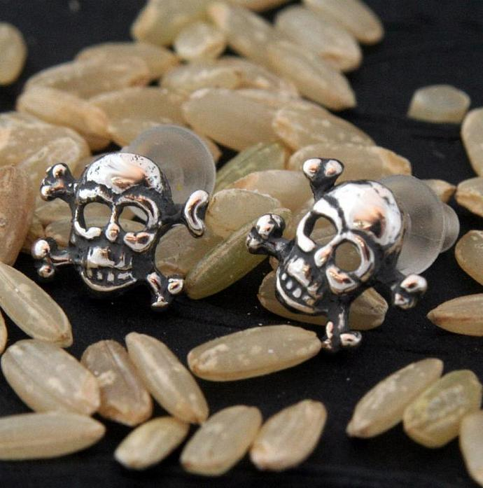 Tiny sterliing silver skull and crossbones post earrings