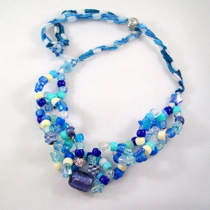 Necklace, bead links in blue and white with adjustable ribbon tie