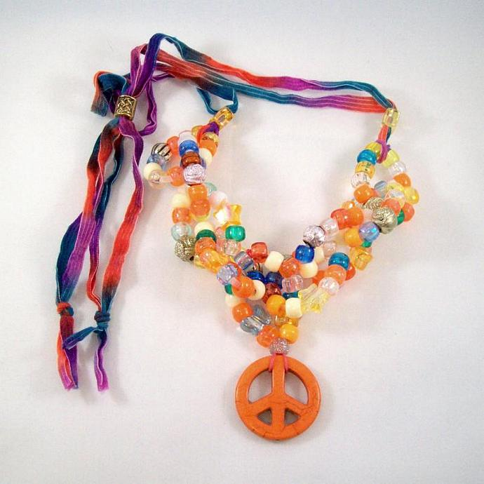 Necklace, bead links in orange with peace sign and adjustable ribbon tie