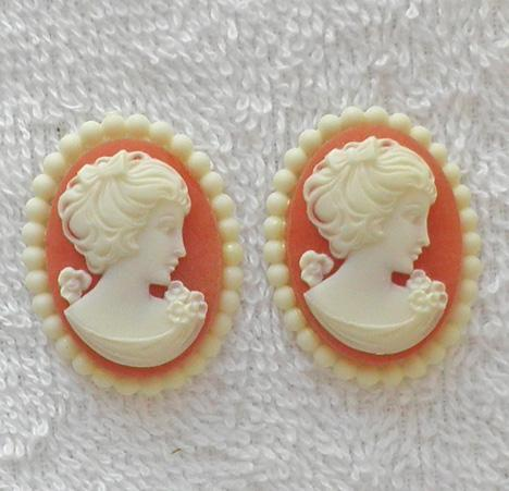 2 fancy edge carnelian and cream W. German 1960s acrylic cameo S73