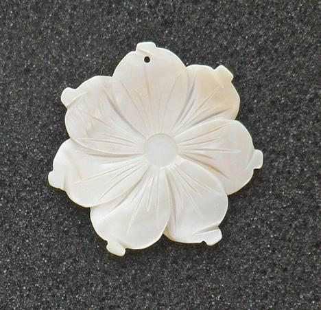 45 mm. carved mother of pearl flower pendant with hole S72