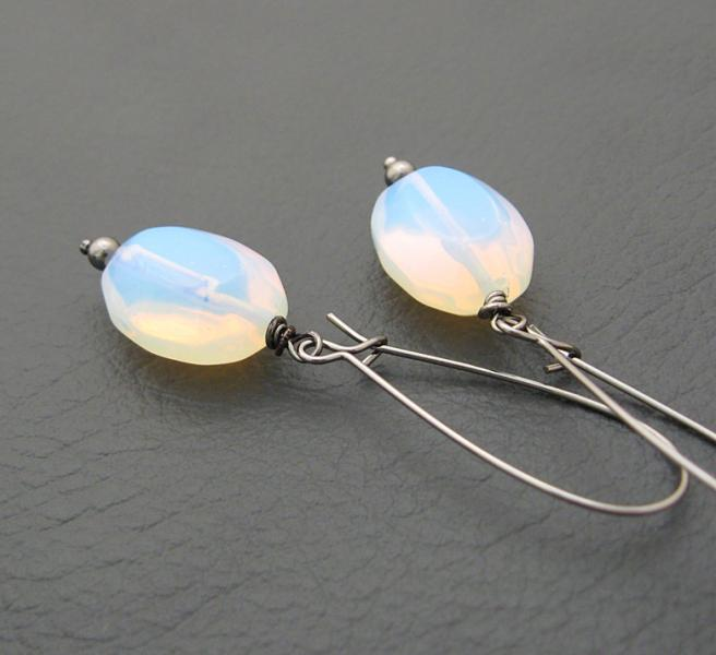 Sea Opal earrings: moon-like glass ovals on long black ear-wires