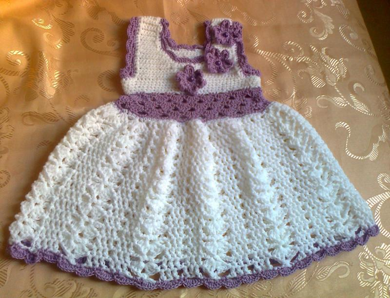 a7780659140f Crochet baby dress in white lilac accent