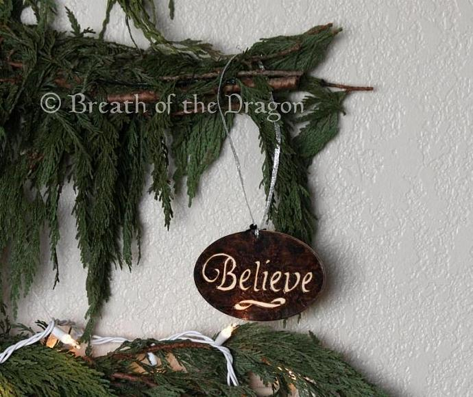 Dark BELIEVE oval ornament