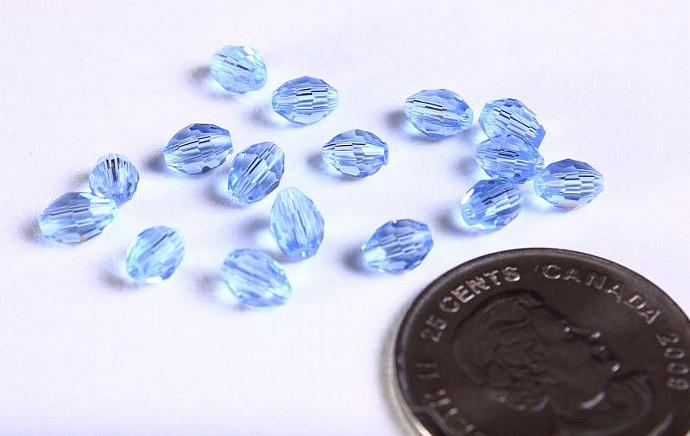 16 Blue rice oval faceted glass bead 6mm x 4mm 16pcs (1103)