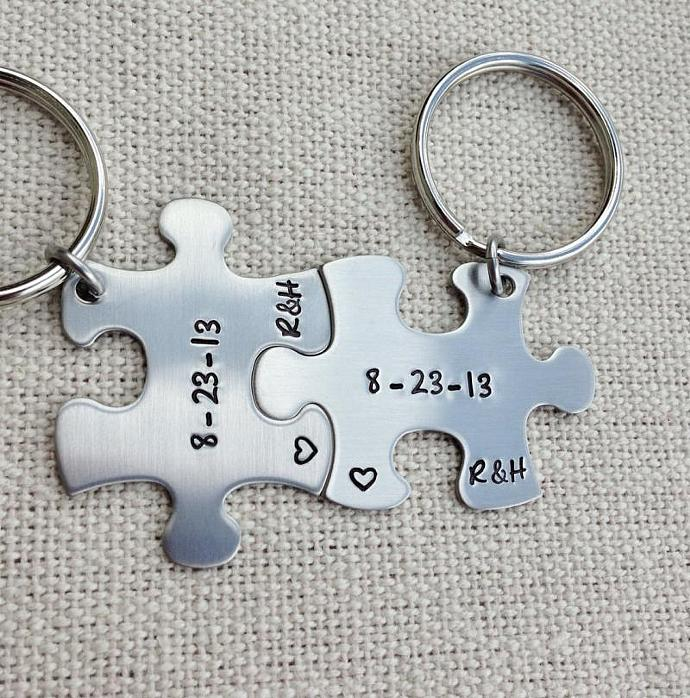 Puzzle piece keychains hand stamped his and hers with date and initials