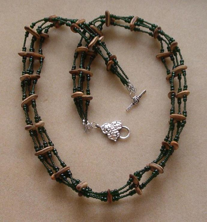4 Strand Necklace - Dark olivine green Ornela seed beads, Royal Poinciana seed