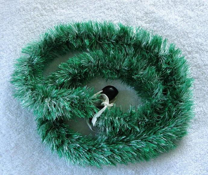 Green and white eyelash lei, finished with black kukui nuts, handmade in Hilo,