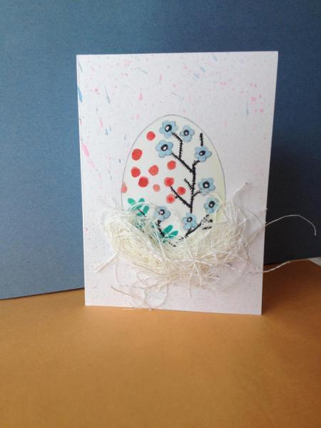 Easter egg in nest card. Spring floral design. All natural materials. Gift idea