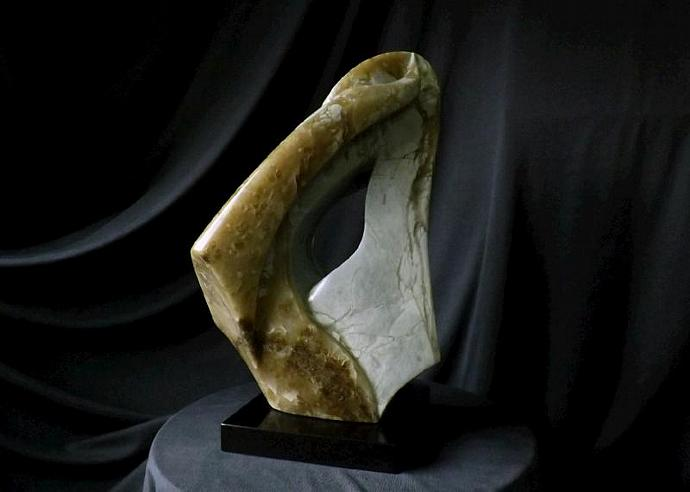 """Abstract Stone Sculpture """" The Seed"""" carved from  Anhydrite stone, on black"""