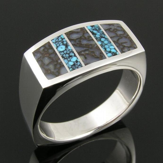 Dinosaur bone ring with spiderweb turquoise in sterling silver