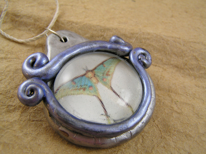 Luna moth pendant in silver and blue