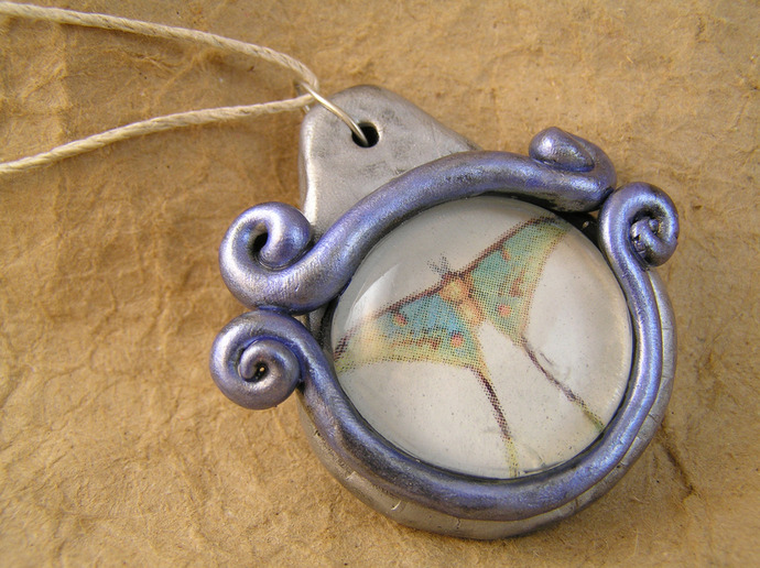 Luna moth pendant in silver and blue