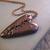 Steampunk broken heart pendant with blue swarovski crystal