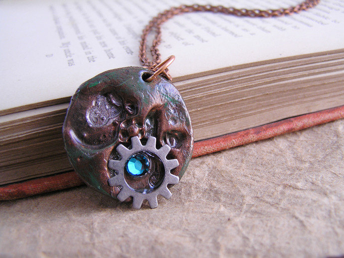 Clockwork pendant with steampunk gear and blue swarovski crystal