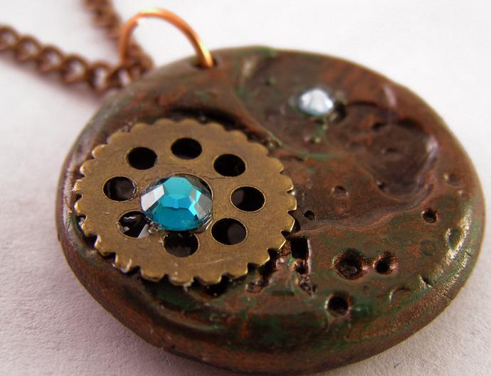 Steampunk pendant with clockwork gear and blue swarovski crystals